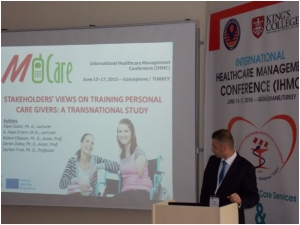 Gazi staff presenting M-CARE at IHMC conference